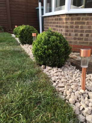 Stones, Buxus and copper lights